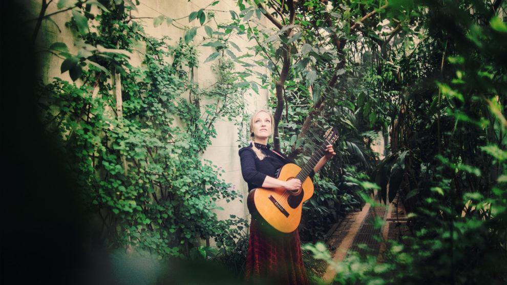 Rowan Godel - singer & songwriter & teacher in a green house