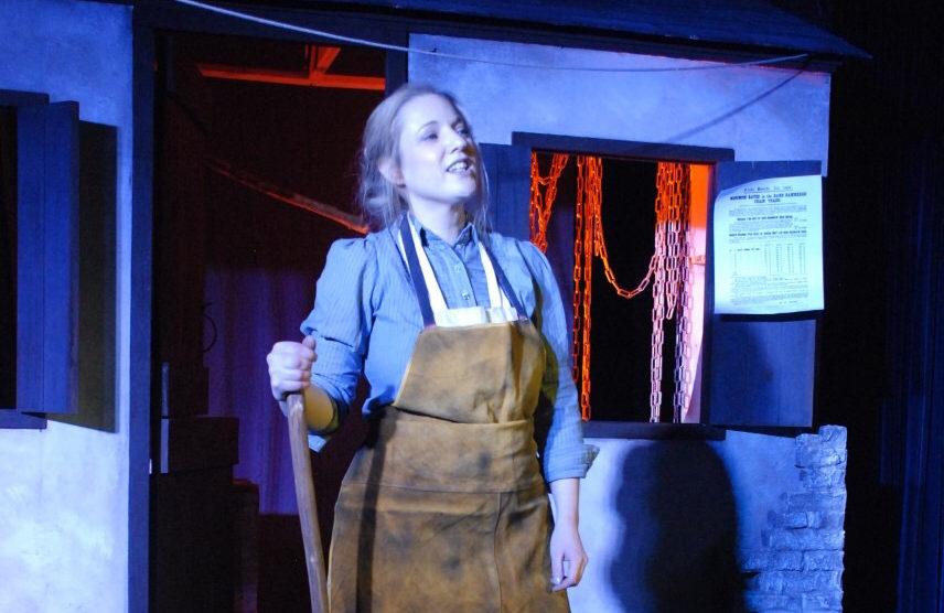 """Rowan Godel on stage for """"Rouse ye women"""""""